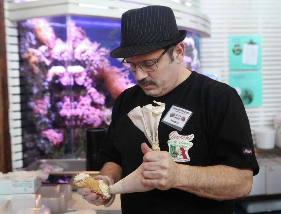 Vincent Scuteri , of Scuteri's Cannoli Connection in Watkins Glen, NY, fills a cannoli at the Chocolate World Expo at the Maritime Aquarium in Norwalk, Conn. on Sunday, January 27, 2013. Photo: BK Angeletti, B.K. Angeletti / Connecticut Post freelance B.K. Angeletti