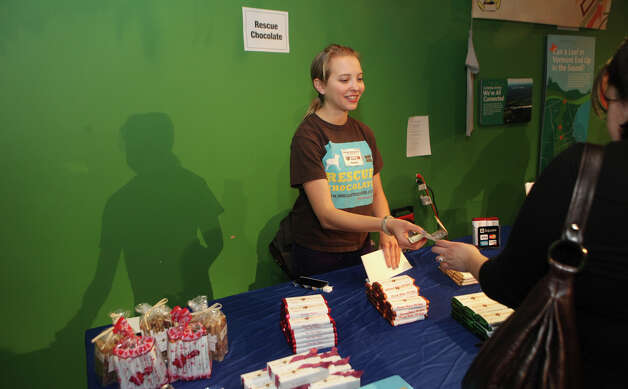 "Sarah Gross, of Brooklyn, NY, sells chocolate bars at the Chocolate World Expo at the Maritime Aquarium in Norwalk, Conn. on Sunday, January 27, 2013. Her chocolate is called "" Rescue Chocolate"" and all the proceeds go to animal shelters. Photo: BK Angeletti, B.K. Angeletti / Connecticut Post freelance B.K. Angeletti"