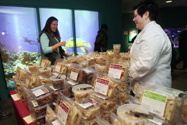Deanna Bellachicco Brealt, of Highland, NY,  right, sells biscotti at the Chocolate World Expo at the Maritime Aquarium in Norwalk, Conn. on Sunday, January 27, 2013. Photo: BK Angeletti, B.K. Angeletti / Connecticut Post freelance B.K. Angeletti