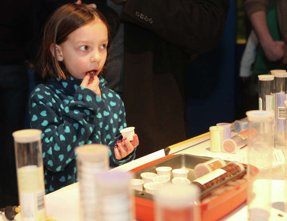 "BZ Pellegrini, 6, of Westport, tries unbaked cookie dough from ""whipped up"" in Weston at the Chocolate World Expo at the Maritime Aquarium in Norwalk, Conn. on Sunday, January 27, 2013. Photo: BK Angeletti, B.K. Angeletti / Connecticut Post freelance B.K. Angeletti"
