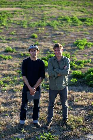 Designers Gaston Nogues (left) and Benjamin Ball stand in a field on Jan. 23, 2013, that will eventually become Confluence Park. The duo have been working to create tentative concepts for the park. Photo: William Luther, San Antonio Express-News / © 2013 San Antonio Express-News