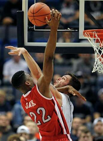 Rutgers' Kadeem Jack (22) is fouled by Connecticut's Enosch Wolf during the second half of an NCAA college basketball game in Hartford, Conn., Sunday, Jan. 27, 2013. UConn won 66-54. (AP Photo/Jessica Hill)