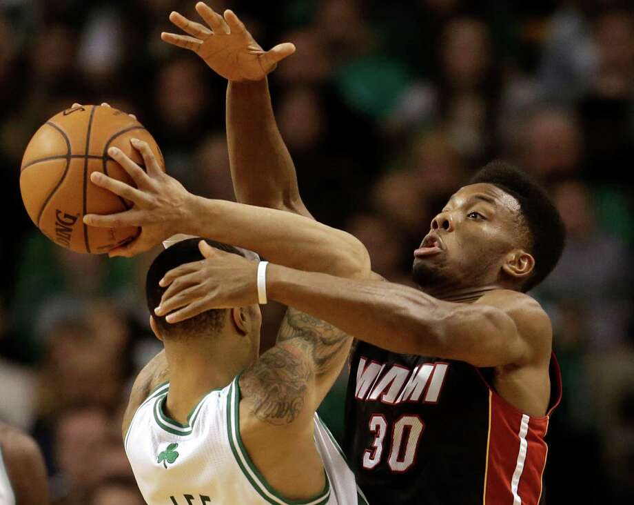 Boston Celtics shooting guard Courtney Lee, left, tries to drive past Miami Heat point guard Norris Cole (30), right, in the first half of an NBA basketball game at the TD Garden in Boston, Sunday, Jan. 27, 2013. (AP Photo/Steven Senne) Photo: Steven Senne, STF / AP