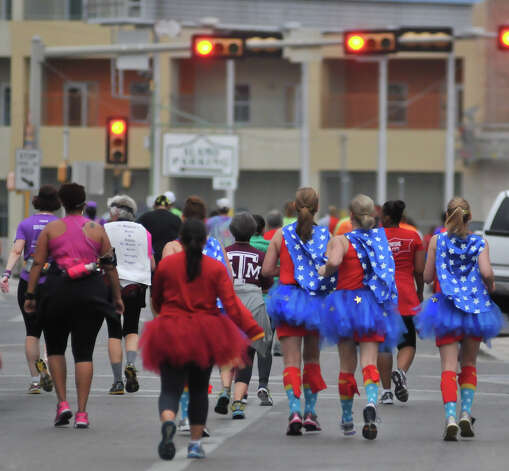 Runners wearing superhero costumes run along Alamo Street in the inaugural  Hero-thon half-marathon Sunday morning. The event benefits the Leukemia and Lymphoma Society. Photo: Robin Jerstad