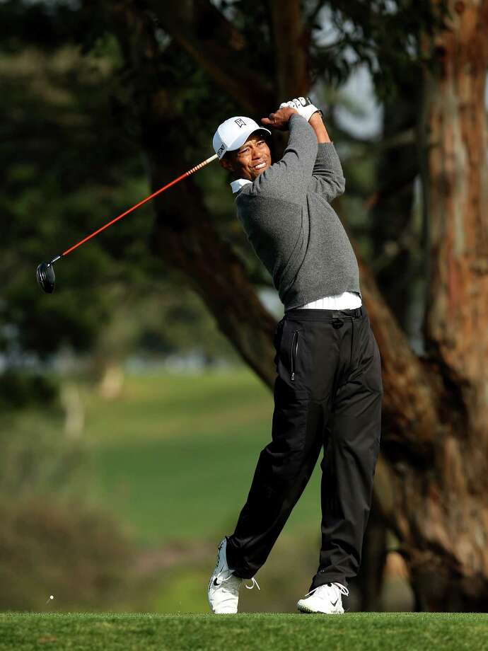 Tiger Woods hits his tee shot on the fifth hole during the third round of the Farmers Insurance Open on the South Course at Torrey Pines Golf Course on January 27, 2013 in La Jolla, California. Photo: Stephen Dunn, Getty Images / 2013 Getty Images