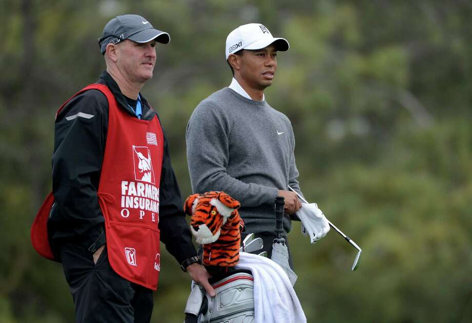 Tiger Woods looks onto the fairway with his caddie during the Third Round at the Farmers Insurance Open at Torrey Pines South Golf Course on January 27, 2013 in La Jolla, California. Photo: Donald Miralle, Getty Images / 2013 Getty Images
