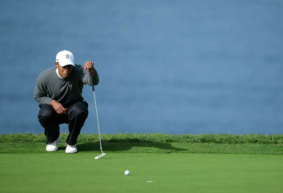 Tiger Woods studies the green during the Third Round at the Farmers Insurance Open at Torrey Pines South Golf Course on January 27, 2013 in La Jolla, California. Photo: Donald Miralle, Getty Images / 2013 Getty Images
