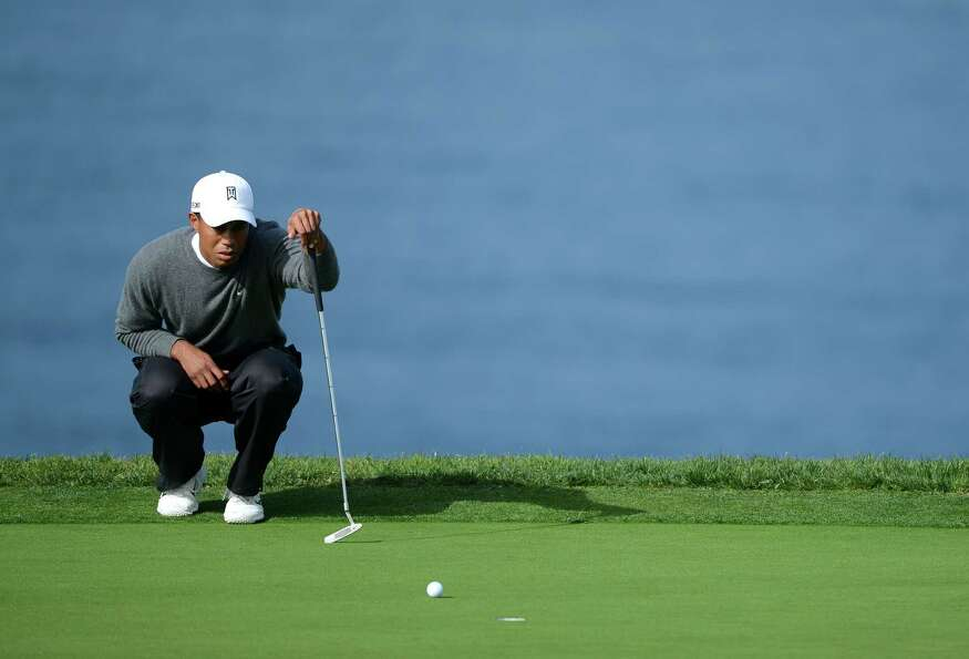 Tiger Woods studies the green during the Third Round at the Farmers Insurance Open at Torrey Pines S