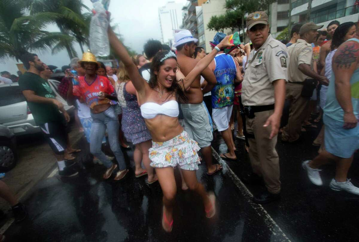 Revelers dance in the streets during the Banda de Ipanema block parade, a pre-Carnival event, in Rio de Janeiro, Brazil, Saturday. According to Rio's tourism office, Rio's street Carnival this year will consist of 492 block parties, attended by an estimated five million Carnival enthusiasts.