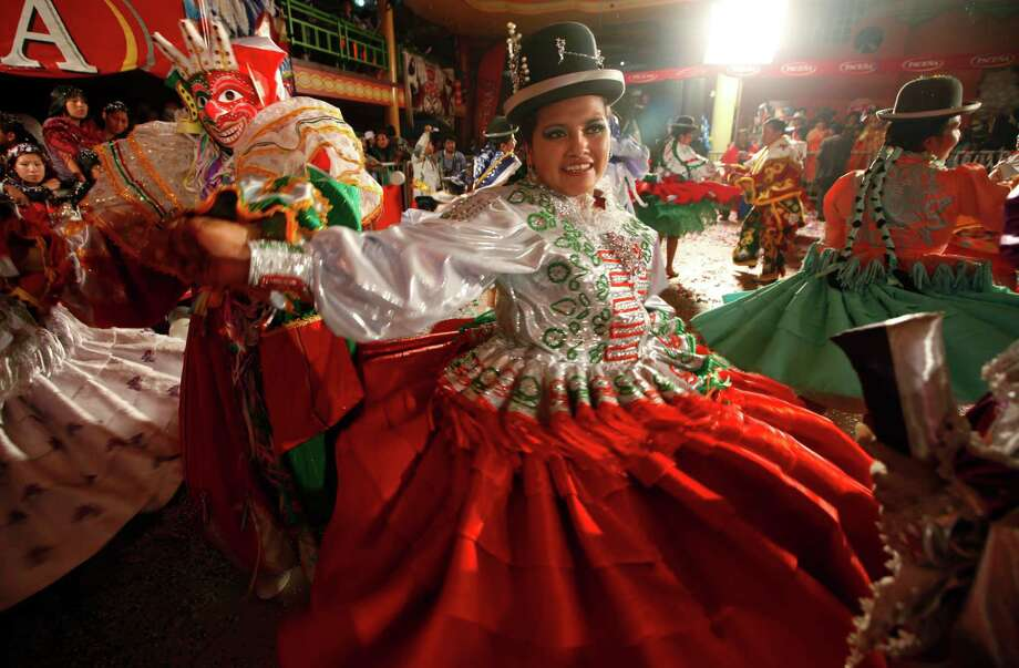 Contestants dance at the end of a local competition that elected the three main 2013 Carnival characters, Chuta, Pepino and Chola, in La Paz, Bolivia, Friday.  Photo: AP