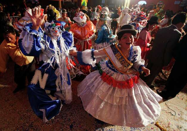 Contestants and revelers dance at the end of a local competition that elected the three main 2013 Carnival characters, Chuta, Pepino and Chola, in La Paz, Bolivia, Friday.  Photo: AP