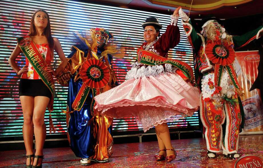Contestants winners celebrate at the end of a local competition that elected them as the three main 2013 Carnival characters; Pepino, second left, Chola, second right, and Chuta, right, in La Paz, Bolivia, Friday. Photo: AP
