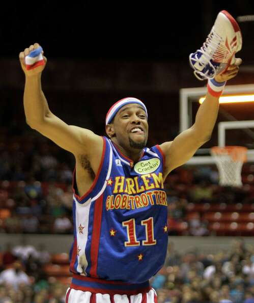 Harlem Globetrotters player Cheese Chisholm performs a skit at Reliant Arena  Sunday, Jan. 27, 2013,