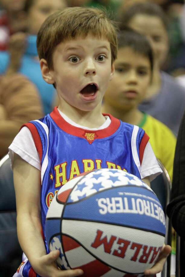 Taylor Cook, 6, of La Grange reacts as he watches the Harlem Globetrotters during performance at Reliant Arena  Sunday, Jan. 27, 2013, in Houston. Photo: Melissa Phillip, Houston Chronicle / © 2013 Houston Chronicle