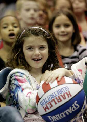 Juliette Hess, 6, of Houston of watches the Harlem Globetrotters during performance at Reliant Arena  Sunday, Jan. 27, 2013, in Houston. Photo: Melissa Phillip, Houston Chronicle / © 2013 Houston Chronicle