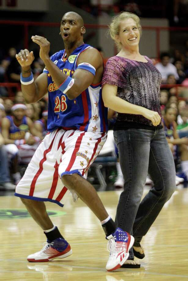 Vicki Bunker of Katy dances with Harlem Globetrotters player Hi-Lite Bruton during performance at Reliant Arena  Sunday, Jan. 27, 2013, in Houston. Photo: Melissa Phillip, Houston Chronicle / © 2013 Houston Chronicle