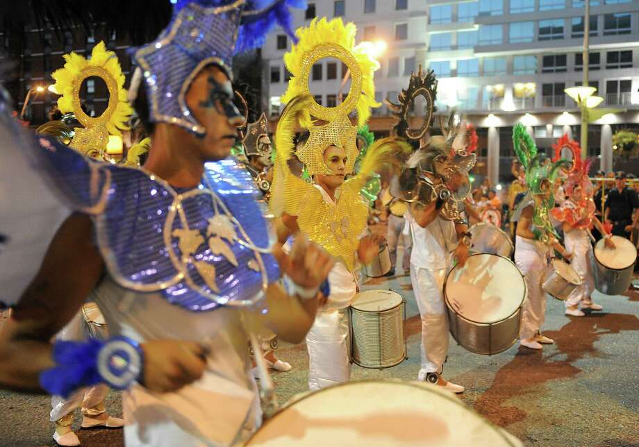 Drummers performs during the samba school parade in Montevideo on Saturday.  Photo: MIGUEL ROJO, Getty / 2013 AFP
