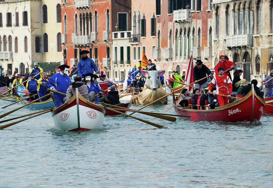 A general view of rowers dressed with costumes and masks taking part in the Water Parade 2013  on the Grand Canal on Sunday in Venice, Italy.  Photo: Marco Secchi, Getty / 2013 Marco Secchi