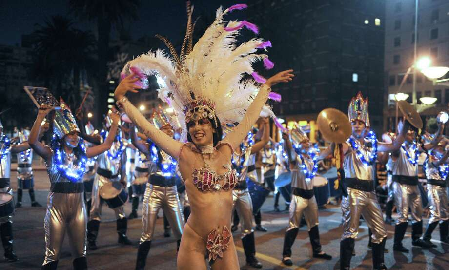 Dancers perform during the samba school parade in Montevideo on Saturday. Photo: MIGUEL ROJO, Getty / 2013 AFP