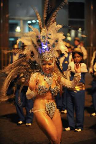 A dancer performs during the samba school parade in Montevideo on Saturday. Photo: MIGUEL ROJO, Getty / 2013 AFP
