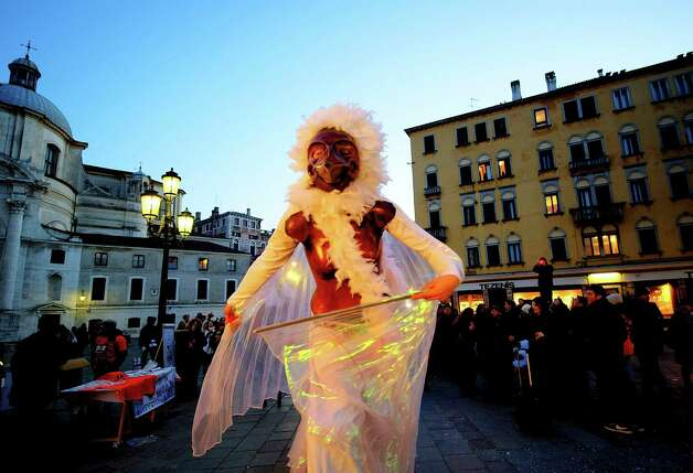 Actors wearing costumes performs ahead of the beginning of the water procession by French theatre company, Ilotopie, on Saturday in Venice, Italy -- the opening of the Venetian Carnival, which runs till February 12th. Photo: Marco Secchi, Getty / 2013 Marco Secchi