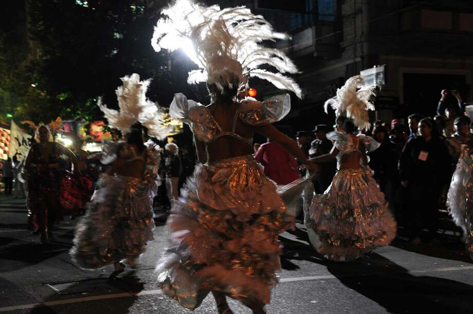 Members of a carnival group perform during the inaugural parade of the Uruguayan carnival on Friday in Montevideo. Photo: MIGUEL ROJO, Getty / 2013 AFP