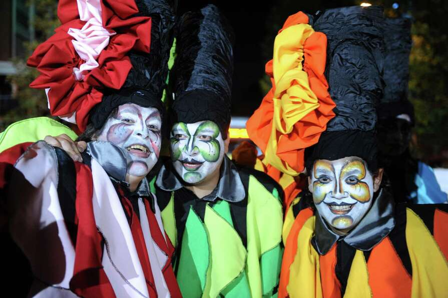 Members of a carnival group pose during the inaugural parade of the Uruguayan carnival on Friday in