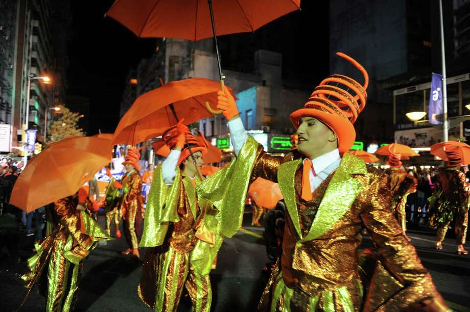 Members of a carnival group perform during the inaugural parade of the Uruguayan carnival on Friday. Photo: MIGUEL ROJO, Getty / 2013 AFP