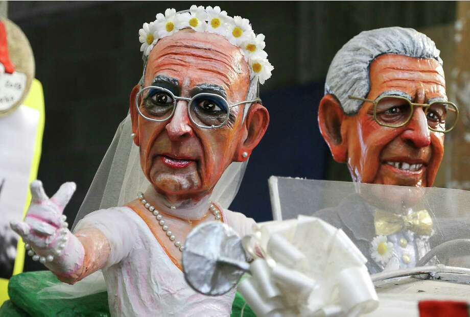 A float showing just married's Italian President Giorgio Napolitano (L) and Prime Minister Mario Monti is displayed at the Cittadella del Carnevale, the workshops . Photo: AFP, Getty / 2013 AFP