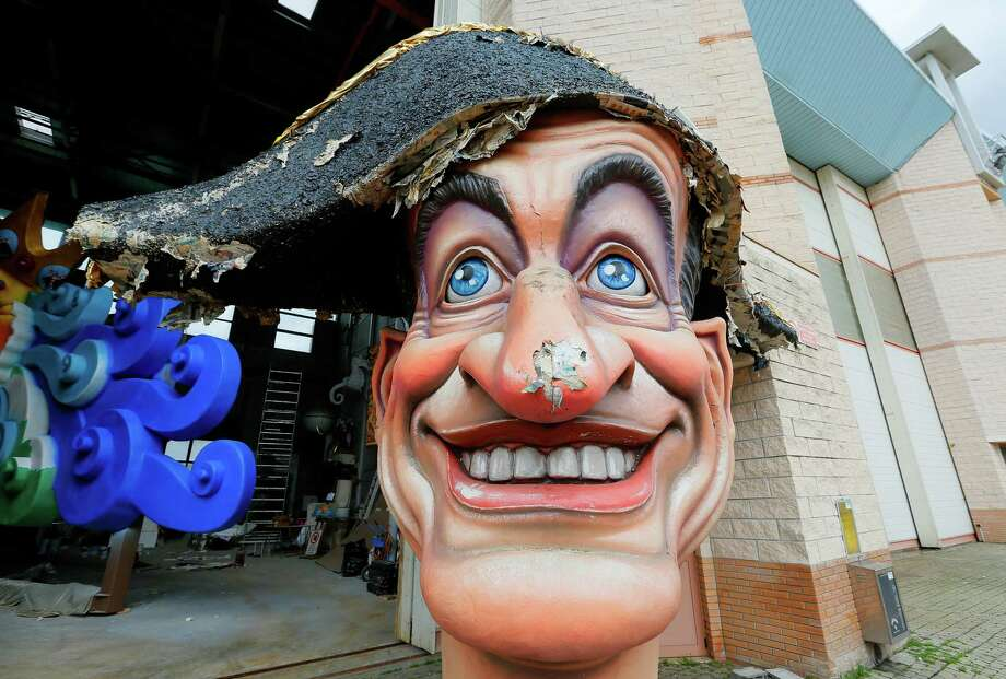 A last year's giant carnival mask showing French politician Nicolas Sarkozy is diplayed outside  the Cittadella del Carnevale, the workshops where the masks and floats for the carnival of Viareggio are being built. Photo: AFP, Getty / 2013 AFP