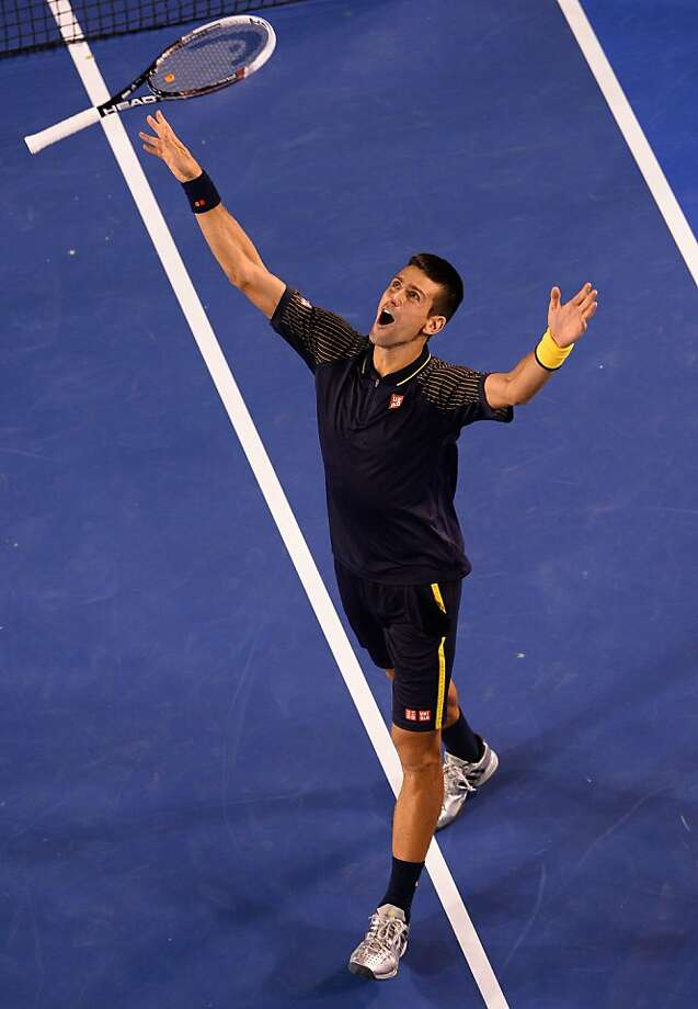 Novak Djokovic celebrates his 6-7 (2), 7-6 (3), 6-3, 6-2 victory over Andy Murray. Djokovic has won four titles in Melbourne, including the past three. Photo: William West, AFP/Getty Images