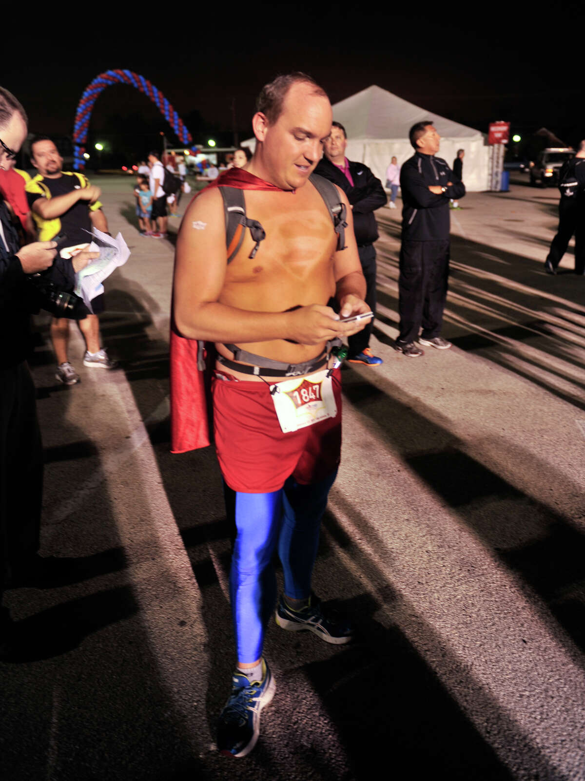 After using a Superman stencil in a tanning bed for three weeks, the man of steel's logo is prominent on the chest of David Uminski prior to the start of the inaugural Hero-thon half-marathon early Sunday morning. The event benefits the Leukemia and Lymphoma Society.