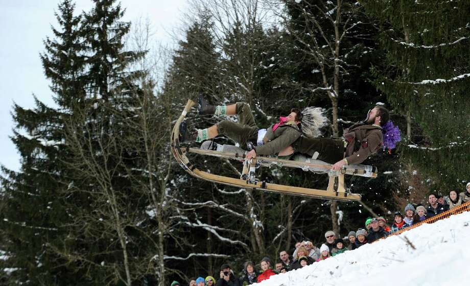 One last wild ride during the Schnablerrennen sled race in Gaissach, Germany, Sunday. (AP Photo/dpa/Tobias Hase) Photo: Multiple