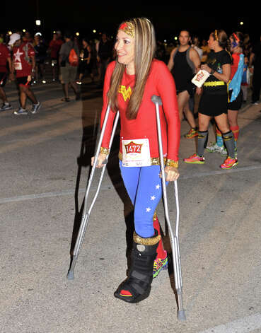 A recently torn ankle ligament wasn't going to deter Melissa Barrera-Pintor, dressed as Wonder Woman, from participating in the inaugural Hero-thon half-marathon early Sunday. The event benefits the Leukemia and Lymphoma Society. Photo: Robin Jerstad