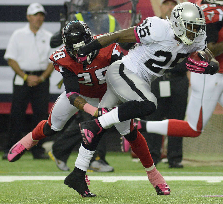 Mike Goodson (25), Oakland Raiders running back Photo: Billy Weeks, Associated Press / FR67639 AP