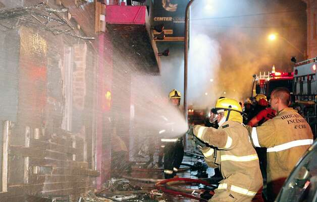 Firefighters try to put out a fire at a nightclub in Santa Maria, 550 Km from Porto Alegre, southern Brazil on January 27, 2012. The death toll climbed to 150 early Sunday as firefighters searched the charred remains of the establishment, television Globo reported. AFP PHOTO / AGENCIA RBS / GERMANO RORATTO / BRAZIL OUTGermano Roratto/AFP/Getty Images Photo: Germano Roratto, AFP/Getty Images