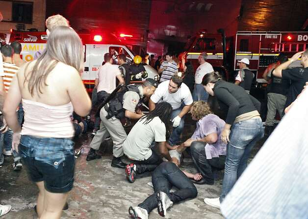 The victims of a nightclub fire receive medical assistance in a street of Santa Maria, 550 Km from Porto Alegre, southern Brazil on January 27, 2012. The death toll climbed to 150 early Sunday as firefighters searched the charred remains of the establishment, television Globo reported. AFP PHOTO / AGENCIA RBS / GERMANO RORATTO / BRAZIL OUTGermano Roratto/AFP/Getty Images Photo: Germano Roratto, AFP/Getty Images