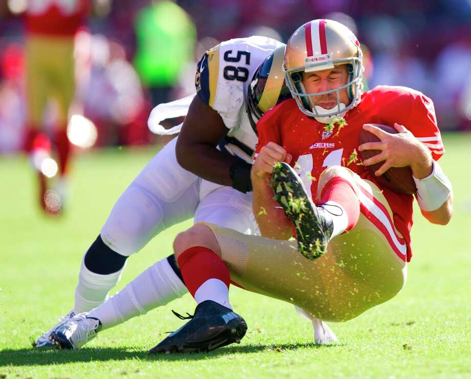 1. Sunday, November 11, 2012: With two plays left in the first quarter, quarterback Alex Smith was hammered by Rams linebacker Jo-Lonn Dunbar. The resulting concussion, which caused blurred vision, sent Smith to the bench for the rest of the season and led to the brilliant ascension of Colin Kaepernick. Photo: Paul Kitagaki Jr., Associated Press / The Sacramento Bee
