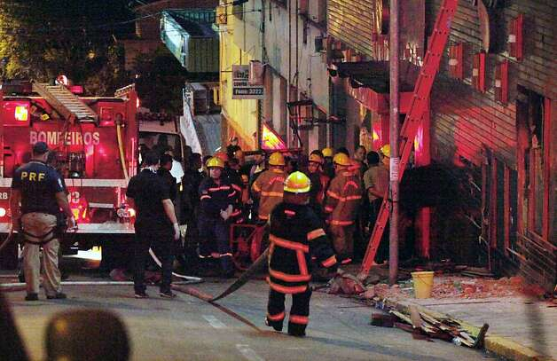 Firefighters try to put out a fire at a nightclub in Santa Maria, 550 Km from Porto Alegre, southern Brazil on January 27, 2012. The death toll climbed to 150 early Sunday as firefighters searched the charred remains of the establishment, television Globo reported. Brazilian President Dilma Rousseff interrupted her visit to Chile. AFP PHOTO / AGENCIA RBS / GERMANO RORATTO / BRAZIL OUTGermano Roratto/AFP/Getty Images Photo: Germano Roratto, AFP/Getty Images