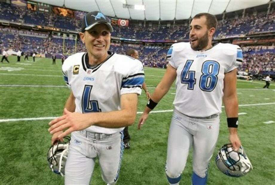 Don Muhlbach (right), Detroit Lions long snapper Photo: Associated Press