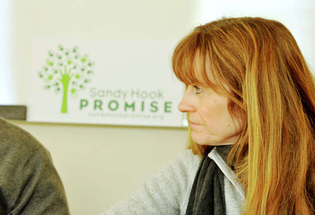 Suzy DeYoung, co-founder and core team member of Sandy Hook Promise, listens during a meeting in the organization's offices in Newtown on Thursday, Jan. 24, 2013. Photo: Jason Rearick / The News-Times