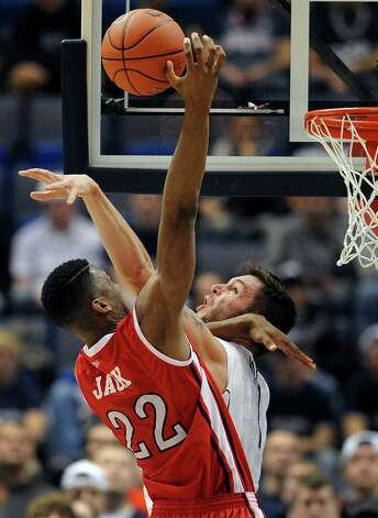 Rutgers' Kadeem Jack (22) is fouled by Connecticut's Enosch Wolf during the second half of an NCAA college basketball game in Hartford, Conn., Sunday, Jan. 27, 2013. Connecticut won 66-54. (AP Photo/Jessica Hill) Photo: Jessica Hill, Associated Press / FR125654 AP