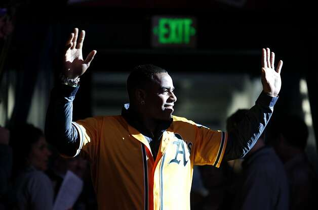 Oakland Athletics outfielder Yoenis Céspedes is introduced to fans at the A's Fanfest at the Oracle Arena on Sunday, January 27, 2013 in Oakland, Calif. Photo: Beck Diefenbach, Special To The Chronicle