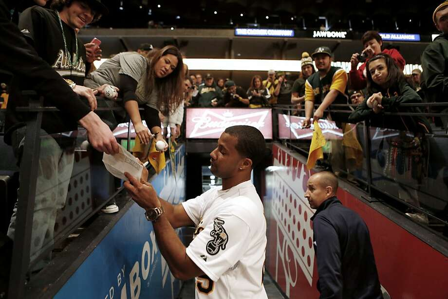 Oakland Athletics outfielders Chris Young signs autographs for fans at the A's Fanfest at the Oracle Arena on Sunday, January 27, 2013 in Oakland, Calif. Photo: Beck Diefenbach, Special To The Chronicle