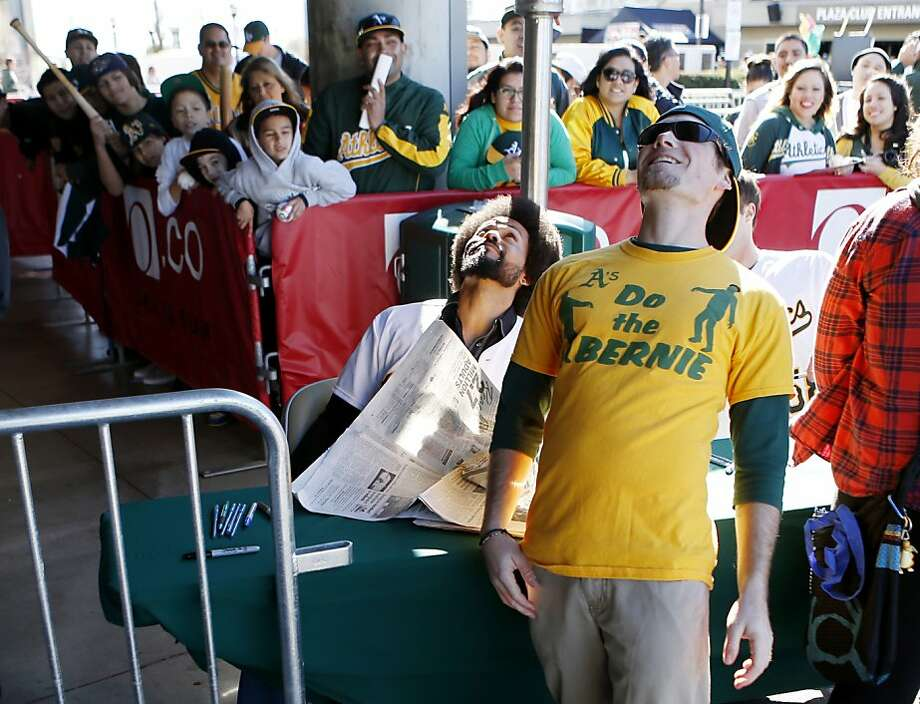 "Matt Griese (right), of Fremont, does the ""Bernie lean"" with Oakland Athletics outfielder Coco Crisp at the A's Fanfest at the Oracle Arena on Sunday, January 27, 2013 in Oakland, Calif. Photo: Beck Diefenbach, Special To The Chronicle"