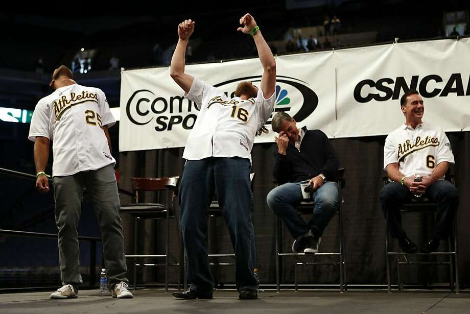 "Oakland Athletics outfielders Chris Young (far left) and Josh Reddick (2nd left) perform the ""Bernie"" as general manager Billy Beane (2nd right) and manager Bob Melvin share a laugh during a questions and answers session at the A's Fanfest at the Oracle Arena on Sunday, January 27, 2013 in Oakland, Calif. Photo: Beck Diefenbach, Special To The Chronicle"