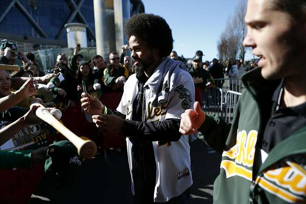 Oakland Athletics outfielder Coco Crisp signs autographs for fans at the A's Fanfest at the Oracle Arena on Sunday, January 27, 2013 in Oakland, Calif. Photo: Beck Diefenbach, Special To The Chronicle