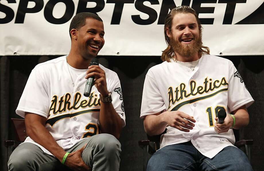 Oakland Athletics outfielders Chris Young (left) and Josh Reddick share a laugh during a questions and answers session  at the A's Fanfest at the Oracle Arena on Sunday, January 27, 2013 in Oakland, Calif. Photo: Beck Diefenbach, Special To The Chronicle