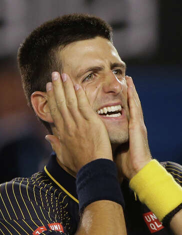 Serbia's Novak Djokovic celebrates his win over Britain's Andy Murray in the men's final at the Australian Open tennis championship in Melbourne, Australia, Sunday, Jan. 27, 2013. (AP Photo/Dita Alangkara) Photo: Dita Alangkara