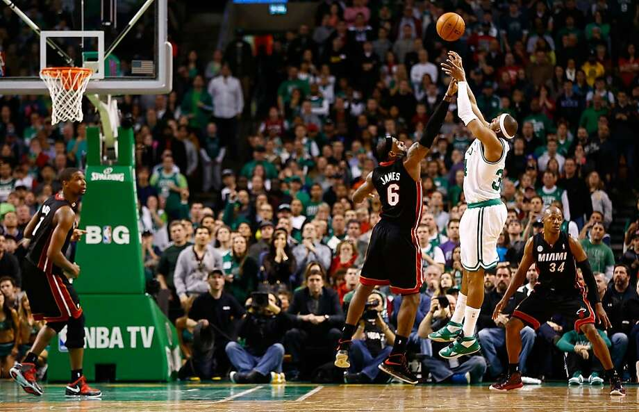Paul Pierce shoots the game-winner over LeBron James with 31 seconds left in the second overtime. The victory ended Boston's six-game losing streak. Photo: Jared Wickerham, Getty Images
